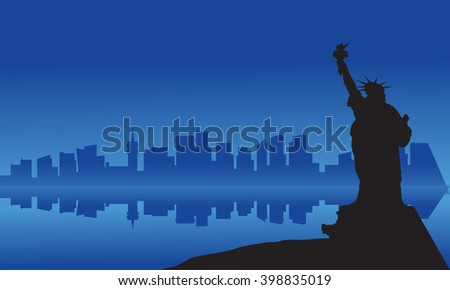 Silhouette of statue liberty from sea at night