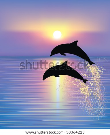 Silhouette of two dolphins jumping out of the water in the ocean at the sunset.