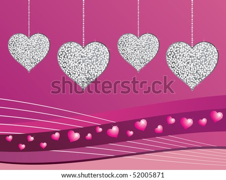 silver glitter heart decorations on pink gradient background