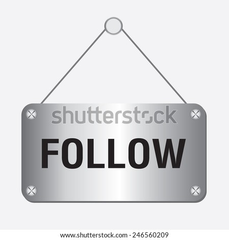 silver metallic follow sign hanging on the wall