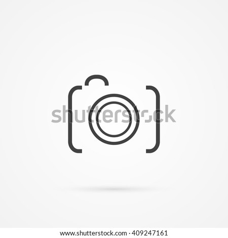 Simple icon of dslr camera. Shadow and white background.