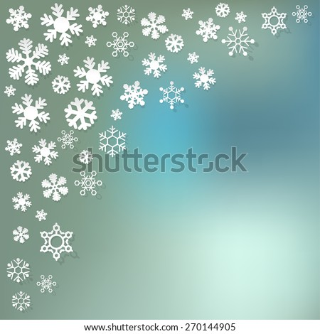 Snowflakes in the corner paper on blue bokeh background