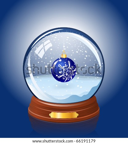 Snowy glass ball with a Christmas-tree decoration within
