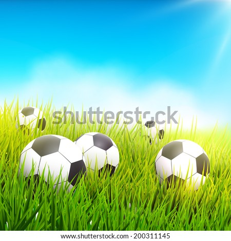 Soccer balls in the grass - football background