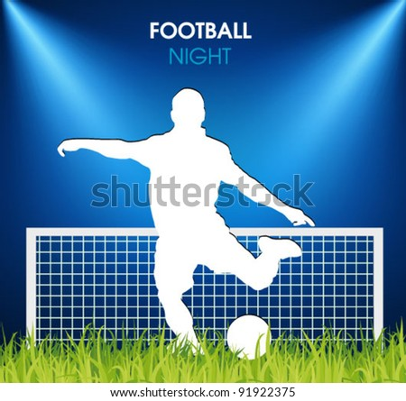 soccer player on the grass in the spotlight