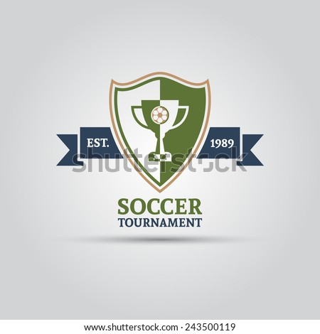 soccer tournament shield with champion cup and ribbon for your text vector isolated logo shield with ribbon for your text - stock vector