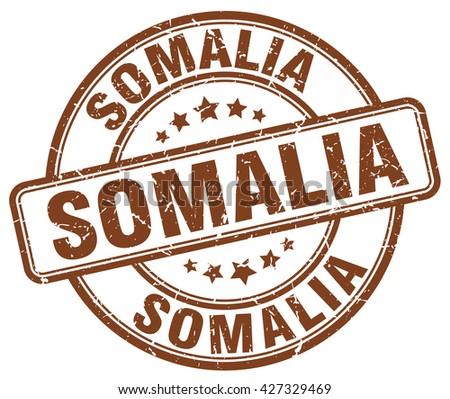 Somalia brown grunge round vintage rubber stamp.Somalia stamp.Somalia round stamp.Somalia grunge stamp.Somalia.Somalia vintage stamp. - stock vector