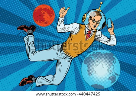 Space businessman with smartphone over the planet Earth and Mars pop art retro vector. New technology. science fiction. Male astronaut. Space business - stock vector
