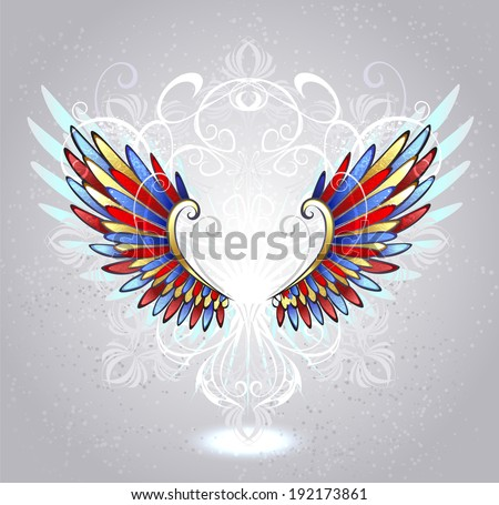 stained glass wings of red, blue and yellow glass , decorated with a white pattern on a light background . - stock vector