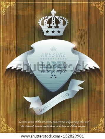 steel badge with wings and crown on  wooden background - stock vector