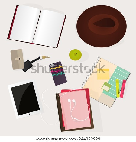 Student desk: apple, tablet, book, notebook, pen, phone, hat, headphone, key - stock vector