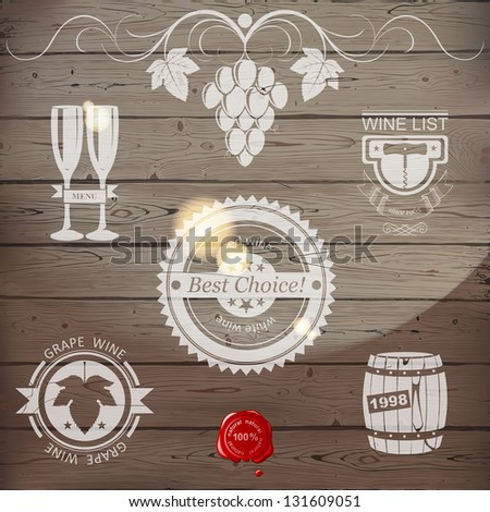 Stylized wine emblems on wooden background. EPS 10. - stock vector