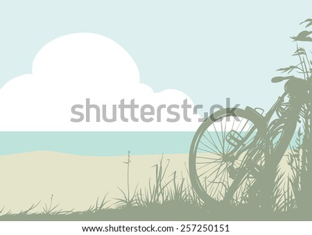 Summer landscape; silhouette of a bicycle against the sea.