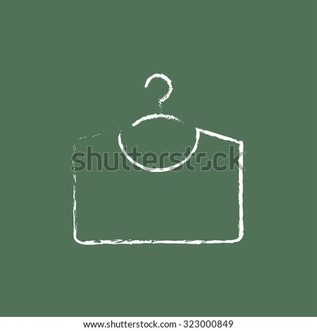 Sweater on hanger hand drawn in chalk on a blackboard vector white icon isolated on a green background. - stock vector