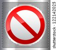 Symbol prohibited sign on a metallic perforated stainless steel sheet - stock photo
