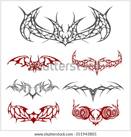 Symmetric tattoo set in tribal style on white background