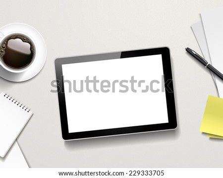 tablet and working place elements over white table