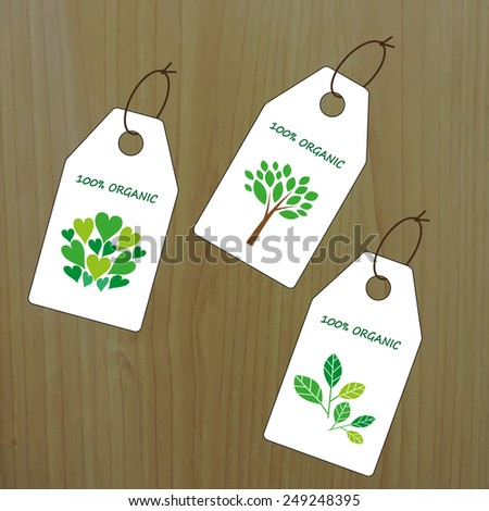 Tag templates on wood background. 100% Organic. Can be used for organic products, food and cosmetics. - stock vector