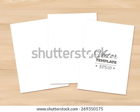 Template of a blank paper sheets on a wooden background. EPS 10 vector.  - stock vector