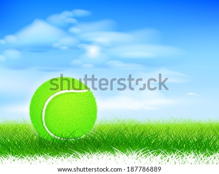 Tennis ball on lush grassy field.