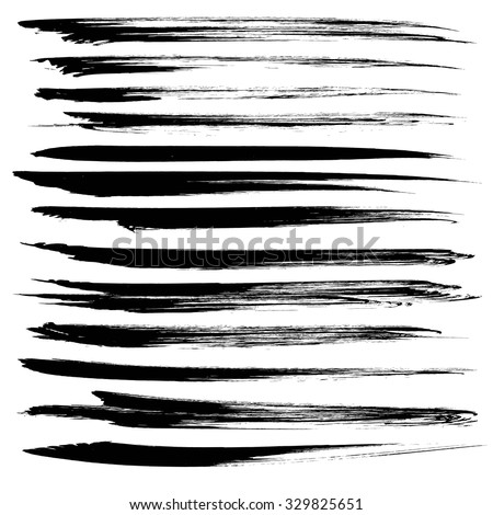 Textured black long strokes of dry paint isolated on white background 1