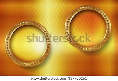 The bright abstract background with gold rings