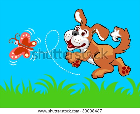 The cheerful puppy plays with the butterfly