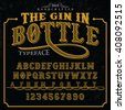 The Gin in Bottle label font and sample label design with decoration. Vintage handcrafted font illustration. Label font. Vector font. vintage font. font illustration. handcrafted font.old font. font
