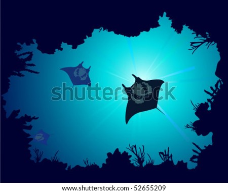 The underwater world with the image of a coral reef and fish manta