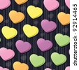 Three-dimensional conversation hearts in pink, purple, green, yellow and orange arranged on a black striped seamless tile; add your own messages (vector contains clipping mask.) - stock photo