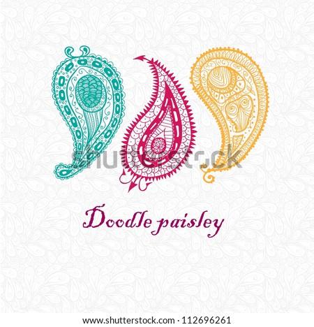 Three doodle paisley elements. - stock vector