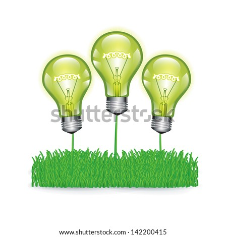 three green light bulbs on grass isolated on white