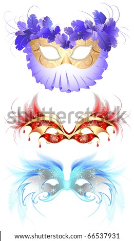three luxury masquerade masks, decorated with elegant decor and fluffy red and blue feathers.