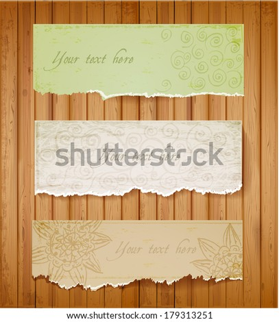 Three vintage ornated paper banner on wooden background  Scrapbook elements. Vector illustration. - stock vector