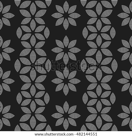 Tiled seamless pattern of hexagons and flowers made of dotted petals. Garlands. Abstract black and white mosaic background. Vector illustration.