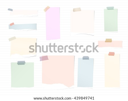 Torn colorful note paper pieces are stuck with sticky tapes on stripes background