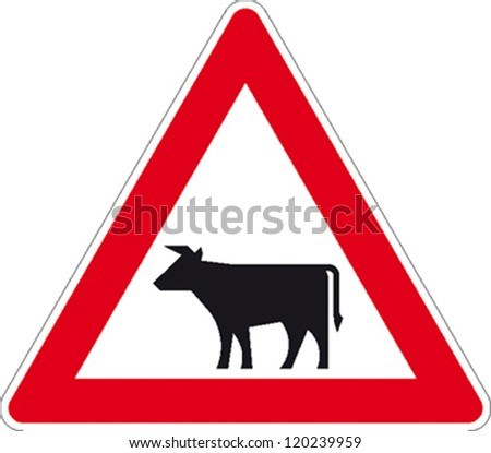 traffic sign attention cow