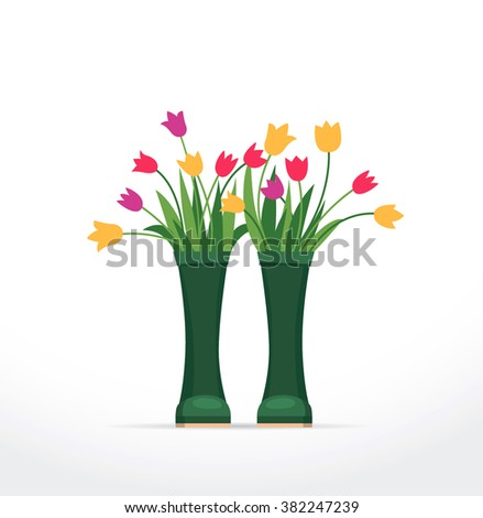 tulips flowers in the rubber boots