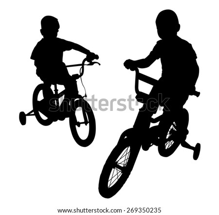 Two boys riding bikes on the promenade. Walk in the Park