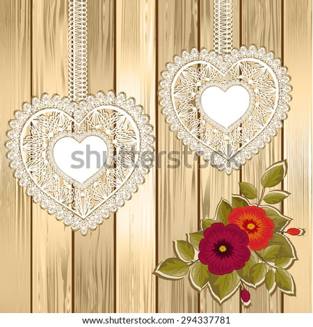 Two lace hearts with flower on wooden background - stock vector