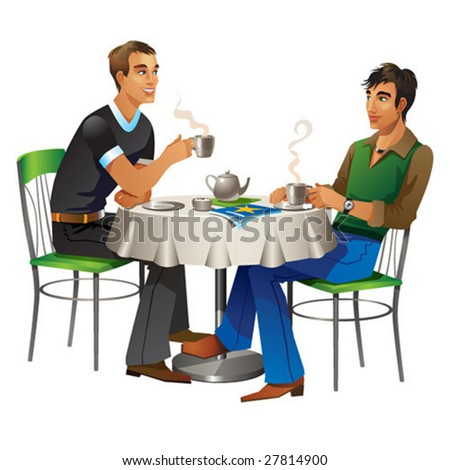 Two young men sit in the cafe