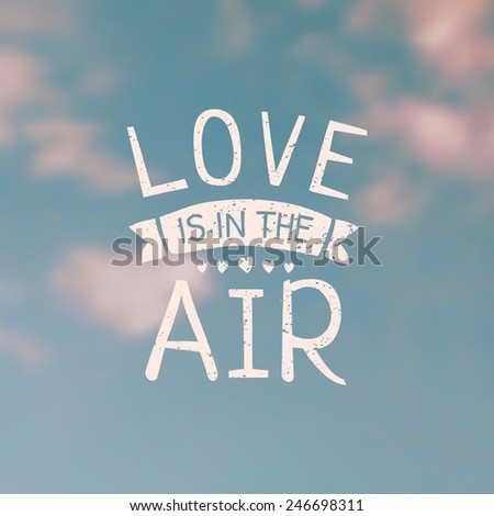 """Typographic design on a blurred vintage sky background. Hand-drawn """"Love Is in the Air"""" message. EPS10 file, gradient mesh used. - stock vector"""