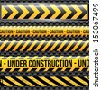 under construction ribbons over black background vector illustration    - stock
