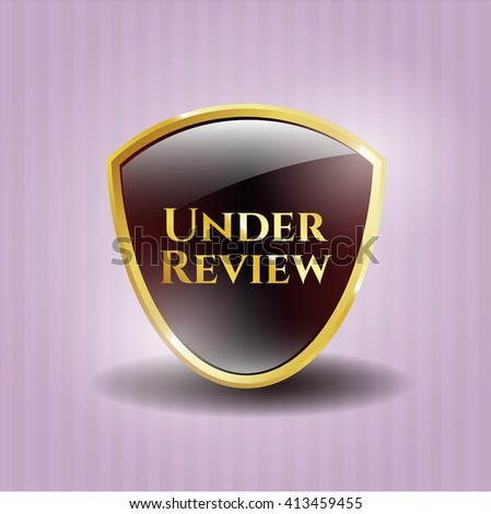 Under Review gold badge or emblem - stock vector