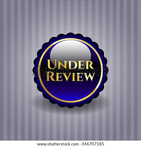Under Review gold shiny emblem - stock vector