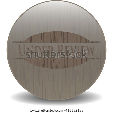 Under Review retro style wood emblem - stock vector