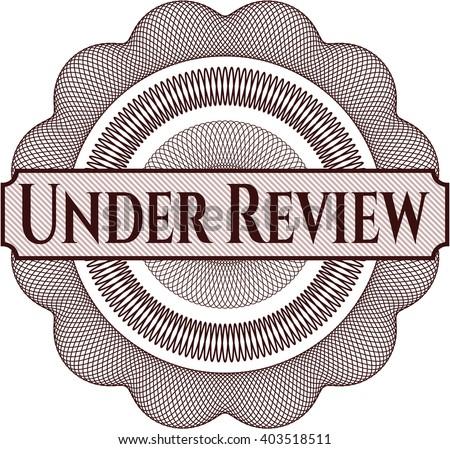 Under Review rosette (money style emplem) - stock vector