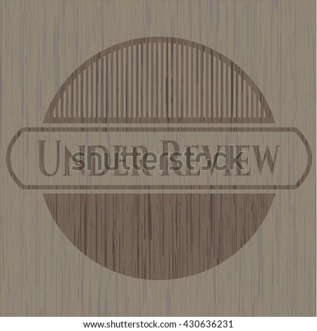 Under Review wood icon or emblem - stock vector