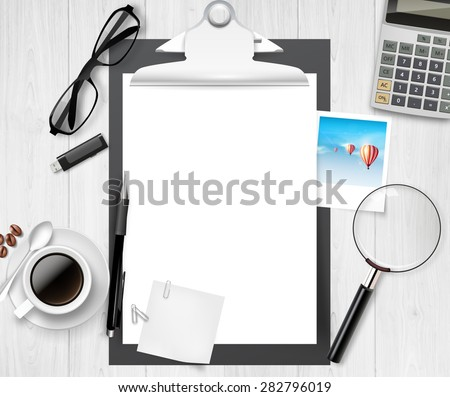 Vector above view of a wooden table, and clipboard with office material on it. - stock vector