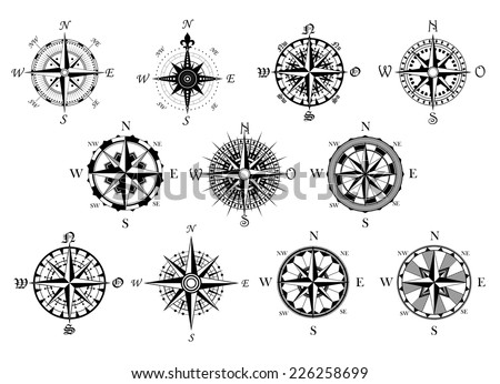 Vector antique compasses with ornate dials for use as design elements in vintage or retro nautical and marine concepts, black and white - stock vector